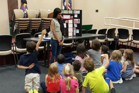 Ramesh at the Cedar Park public library teaching about sugar to young kids.