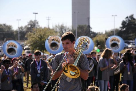"""The band played at the parade on Jan. 23 to commemorate their state win earlier this year. Marching season favorites such as Metal Shop were played as the parade progressed. """"It was a little weird to play stand tunes and march again after all the time off marching season, """" sophomore Claire Sears said. """"But it was really fun to get to hang out with the band members I don't get to see during concert season."""""""